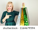 beautiful blonde female... | Shutterstock . vector #1164679594