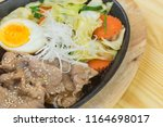 sliced pork steak on hot plate  ... | Shutterstock . vector #1164698017