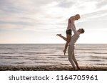 young couple having fun walking ... | Shutterstock . vector #1164705961