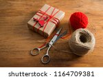 gift box wrapped in recycled... | Shutterstock . vector #1164709381