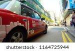 hong kong red taxi driving  ... | Shutterstock . vector #1164725944