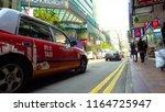 hong kong red taxi driving  ...   Shutterstock . vector #1164725947