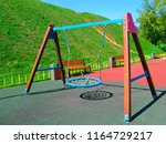 hanging swings at childrens... | Shutterstock . vector #1164729217
