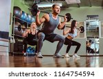 group of people exercising with ... | Shutterstock . vector #1164754594