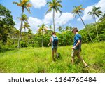 family of mother and son hiking ... | Shutterstock . vector #1164765484