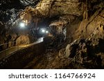 cave with concrete footpath and ... | Shutterstock . vector #1164766924