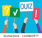 hand holding quiz placard with... | Shutterstock .eps vector #1164863977