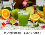 cocktail with apple and fruit... | Shutterstock . vector #1164872554
