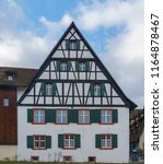 a traditional swiss house in... | Shutterstock . vector #1164878467