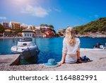 female tourist sitting on the... | Shutterstock . vector #1164882991