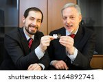 businessmen joining puzzle...   Shutterstock . vector #1164892741