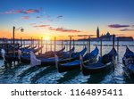 venice with famous gondolas at... | Shutterstock . vector #1164895411