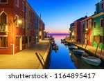 colorful houses at night in... | Shutterstock . vector #1164895417