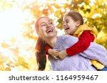 happy family on autumn walk ... | Shutterstock . vector #1164959467