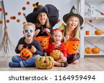 happy brother and three sisters ... | Shutterstock . vector #1164959494