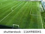 empty football or soccer field...   Shutterstock . vector #1164980041