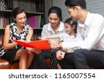 happy young asian family... | Shutterstock . vector #1165007554
