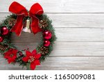 christmas wreath with red bow...   Shutterstock . vector #1165009081