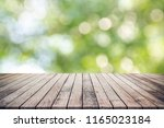 old wood plank with abstract...   Shutterstock . vector #1165023184