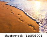 Beach  Wave And Footsteps At...