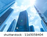 high rise buildings and blue... | Shutterstock . vector #1165058404