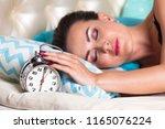 closeup shot of the sleepy... | Shutterstock . vector #1165076224