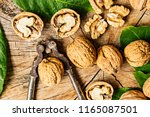 fresh walnuts on an old wooden... | Shutterstock . vector #1165087501