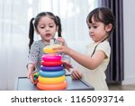 two little girls playing small... | Shutterstock . vector #1165093714