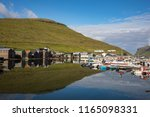 sorvagur is a village on the... | Shutterstock . vector #1165098331