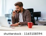 young businessman talking on...   Shutterstock . vector #1165108594