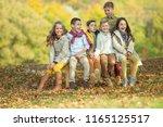 happy autumn children   | Shutterstock . vector #1165125517