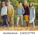 happy autumn children   | Shutterstock . vector #1165127794