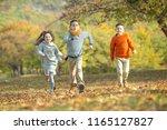 happy autumn children   | Shutterstock . vector #1165127827