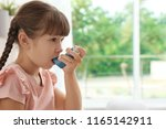 little girl using asthma... | Shutterstock . vector #1165142911