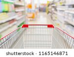 empty shopping cart with... | Shutterstock . vector #1165146871