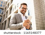 young businessman using mobile... | Shutterstock . vector #1165148377