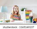 child doing homework at home.... | Shutterstock . vector #1165160137