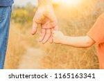 beautiful hands of a happy... | Shutterstock . vector #1165163341