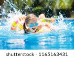 child with inflatable toy ring... | Shutterstock . vector #1165163431