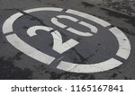 speed restriction sign on road   Shutterstock . vector #1165167841