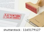 a red stamp on a document  ... | Shutterstock . vector #1165179127