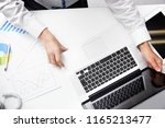 businessman using the pc  no... | Shutterstock . vector #1165213477