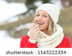 happy woman applying lip balm... | Shutterstock . vector #1165222354