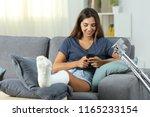 disabled woman using a smart... | Shutterstock . vector #1165233154