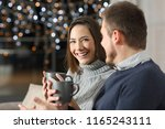 couple talking in the night in... | Shutterstock . vector #1165243111