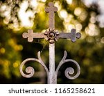 old rusty catholic cross on the ... | Shutterstock . vector #1165258621