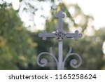 old rusty catholic cross on the ... | Shutterstock . vector #1165258624