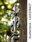 old rusty catholic cross on the ... | Shutterstock . vector #1165258627