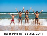 group of four teens standing on ... | Shutterstock . vector #1165272094