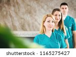 group of nurses standing and... | Shutterstock . vector #1165275427